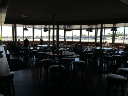 The dining room., complete with wrap-around windows overlooking the ramp and runway!