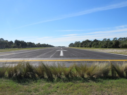 "Runway 23 at Cedar Key, quite the ""boundary fence"" you can see between a road (where I was) and the runway... (12/12)"