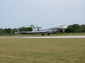 A Global Express landing, my vantage point just outside the runway safety area was just slightly beyond the touchdown zone (large white areas on the runway).